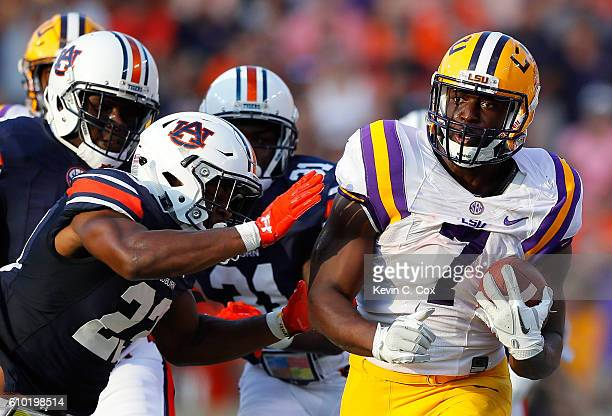 Leonard Fournette of the LSU Tigers is pushed out of bound by Johnathan Ford of the Auburn Tigers at JordanHare Stadium on September 24 2016 in...