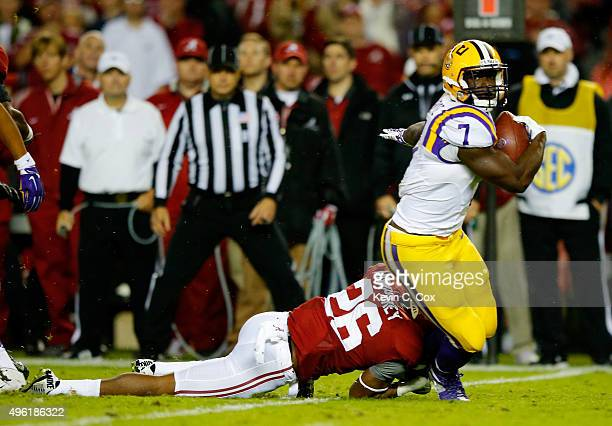 Leonard Fournette of the LSU Tigers is tackled by Marlon Humphrey of the Alabama Crimson Tide in the second quarter at BryantDenny Stadium on...