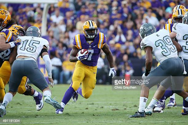 Leonard Fournette of the LSU Tigers runs against the Eastern Michigan Eagles defense at Tiger Stadium on October 3 2015 in Baton Rouge Louisiana