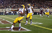 Leonard Fournette of the LSU Tigers runs for a 22yard touchdown against the Texas AM Aggies in the first half of their game at Kyle Field on November...
