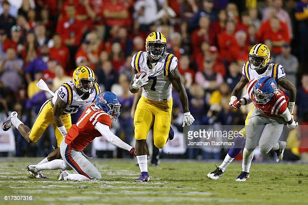 Leonard Fournette of the LSU Tigers runs for a 76yard touchdown during the first half of a game against the Mississippi Rebels at Tiger Stadium on...