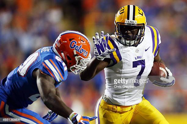 Leonard Fournette of the LSU Tigers runs for a first down past Marcus Maye of the Florida Gators at Tiger Stadium on October 17 2015 in Baton Rouge...