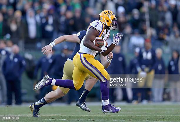 Leonard Fournette of the LSU Tigers runs for a touchdown against the Notre Dame Fighting Irish during the Franklin American Mortgage Music City Bowl...