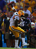 Leonard Fournette of the LSU Tigers runs past the attempted tackle by Tray Matthews of the Auburn Tigers at Tiger Stadium on September 19 2015 in...