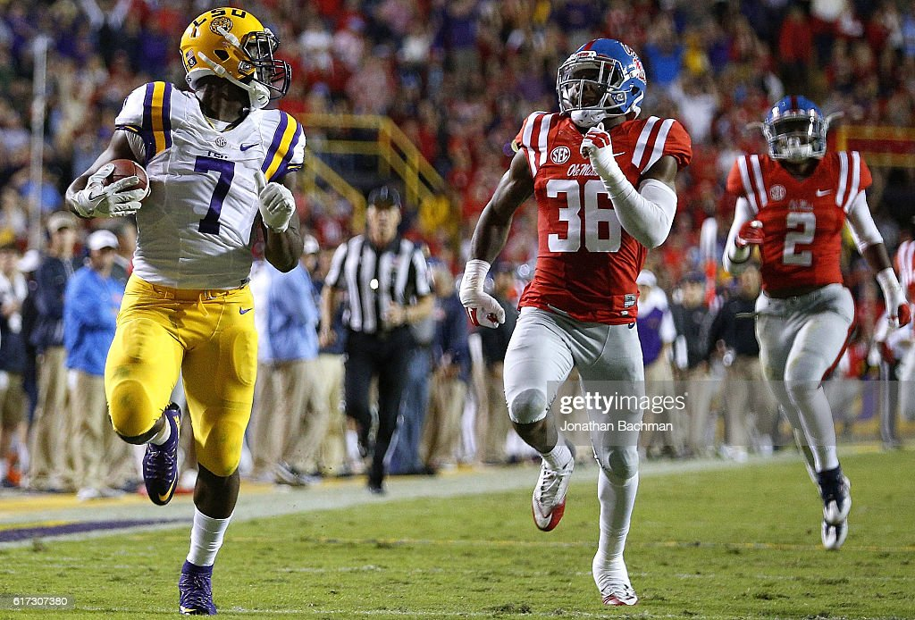 Leonard Fournette #7 of the LSU Tigers runs past Zedrick Woods #36 of the Mississippi Rebels for a 76-yard touchdown during the first half of a game at Tiger Stadium on October 22, 2016 in Baton Rouge, Louisiana.