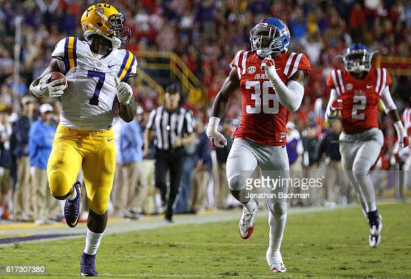 Leonard Fournette of the LSU Tigers runs past Zedrick Woods of the Mississippi Rebels for a 76yard touchdown during the first half of a game at Tiger...