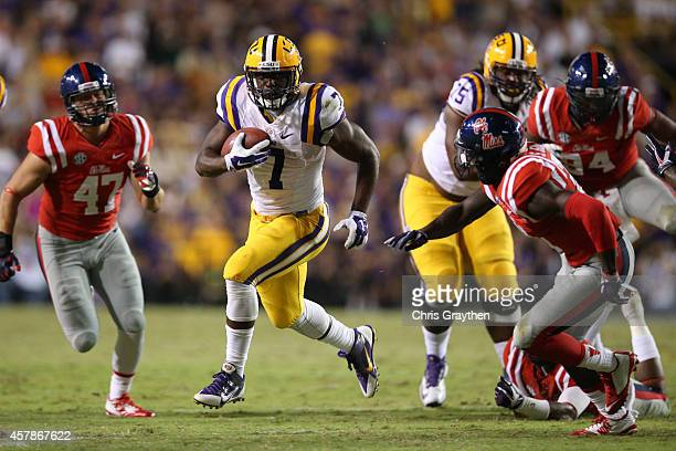 Leonard Fournette of the LSU Tigers runs the ball against the Mississippi Rebels at Tiger Stadium on October 25 2014 in Baton Rouge Louisiana