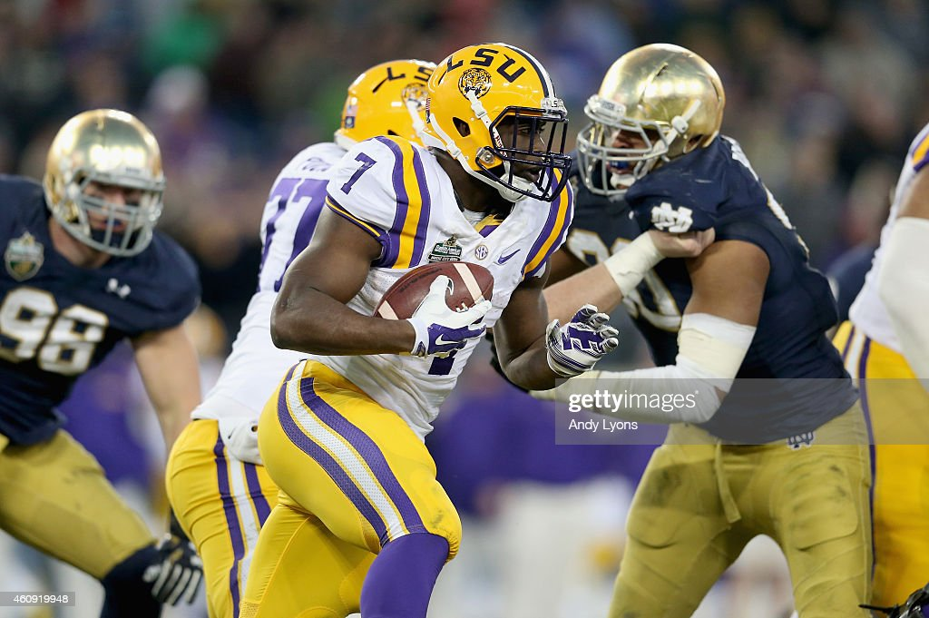 Leonard Fournette of the LSU Tigers runs with the ball against the Notre Dame Fighting Irish during the Franklin American Mortgage Music City Bowl at...