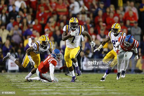Leonard Fournette of the LSU Tigers runs with the ball during a game against the Mississippi Rebels at Tiger Stadium on October 22 2016 in Baton...