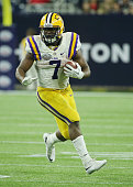 Leonard Fournette of the LSU Tigers runs with the ball during the second half of their game against the Texas Tech Red Raiders during the AdvoCare...