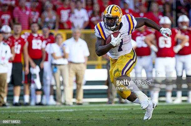 Leonard Fournette of the LSU Tigers runs with the ball in the fourth quarter against the Wisconsin Badgers at Lambeau Field on September 3 2016 in...