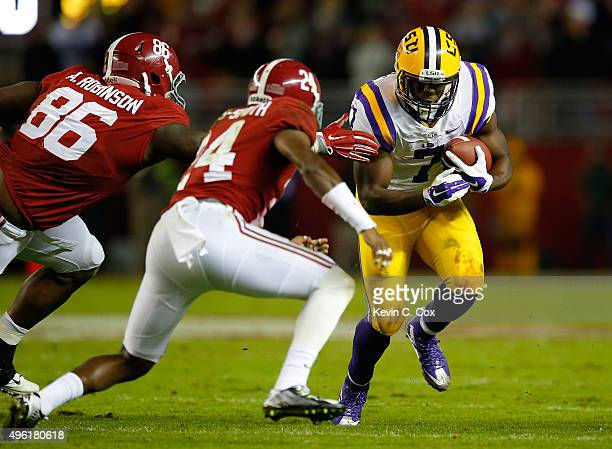 Leonard Fournette of the LSU Tigers rushes against A'Shawn Robinson and Geno MatiasSmith of the Alabama Crimson Tide in the second quarter at...