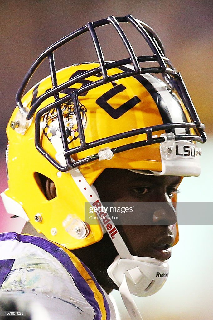 Leonard Fournette of the LSU Tigers walks off the field after having his face mask pulled off his helmet during the game against the Mississippi...