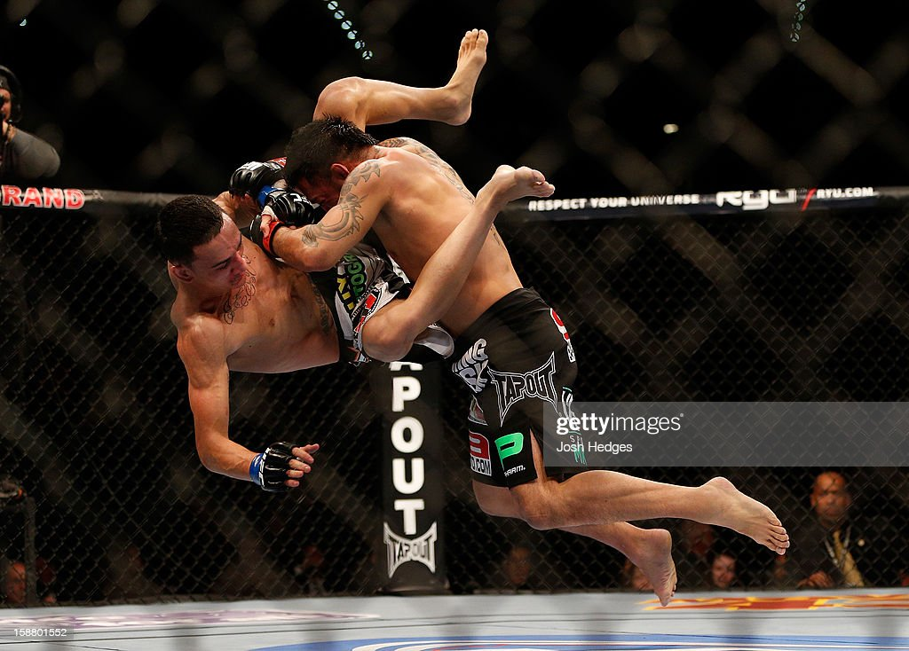 Leonard Garcia slams Max Holloway during their featherweight fight at UFC 155 on December 29, 2012 at MGM Grand Garden Arena in Las Vegas, Nevada.