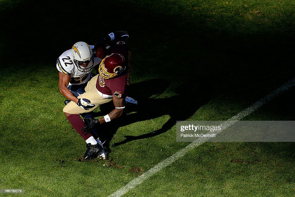 Leonard Hankerson #85 of the Washington Redskins is tackled by Derek Cox #22 of the San Diego Chargers in the first quarter during an NFL game at FedExField on November 3, 2013 in Landover, Maryland.