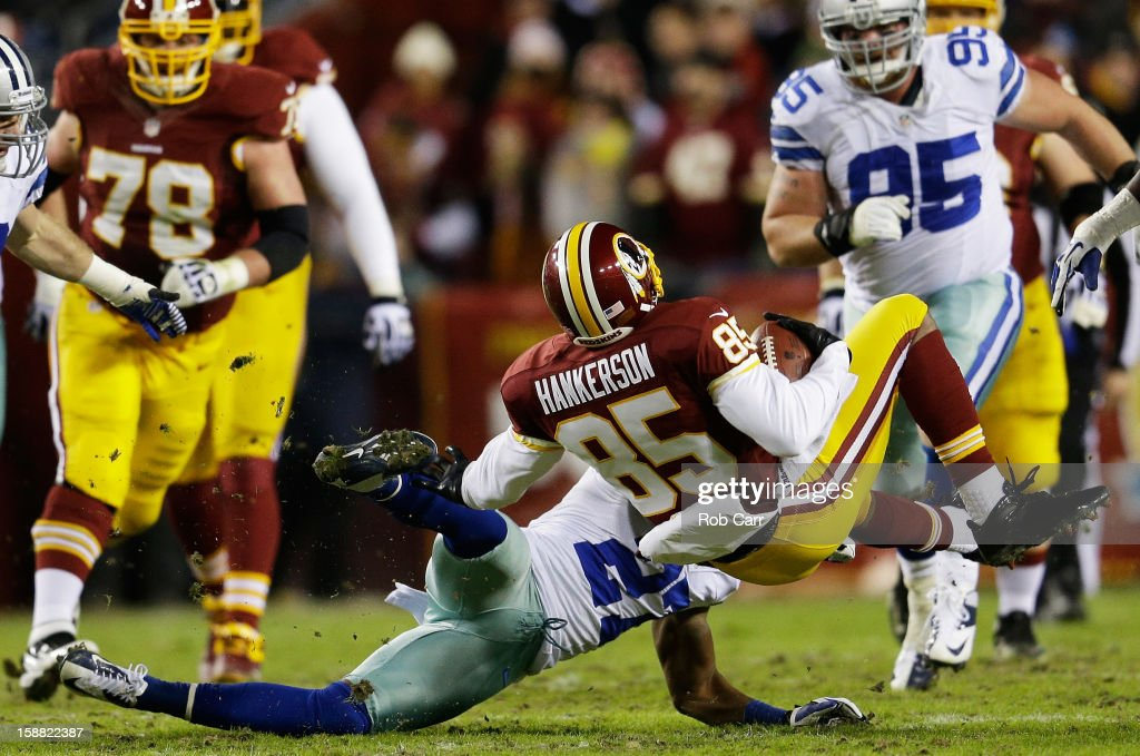 Leonard Hankerson #85 of the Washington Redskins is tackled by Eric Frampton #27 of the Dallas Cowboys in the second quarter at FedExField on December 30, 2012 in Landover, Maryland.