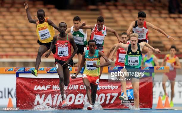 Leonard Kipkemoi Bett of Kenya Girma Diriba of Ethiopia and Robert De Villiers of South Africa compete in the boy's 2000m Steeplechase during day...