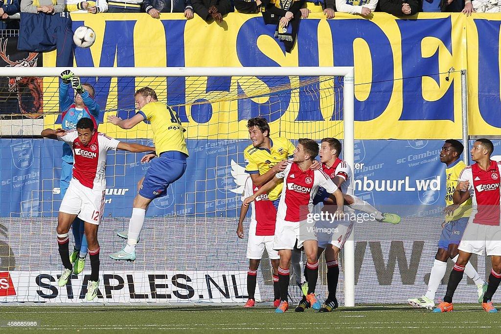 Leonard Nienhuis of SC Cambuur Jairo Riedewald of Ajax Michiel Hemmen of SC Cambuur during the Dutch Eredivisie match between SC Cambuur Leeuwarden...