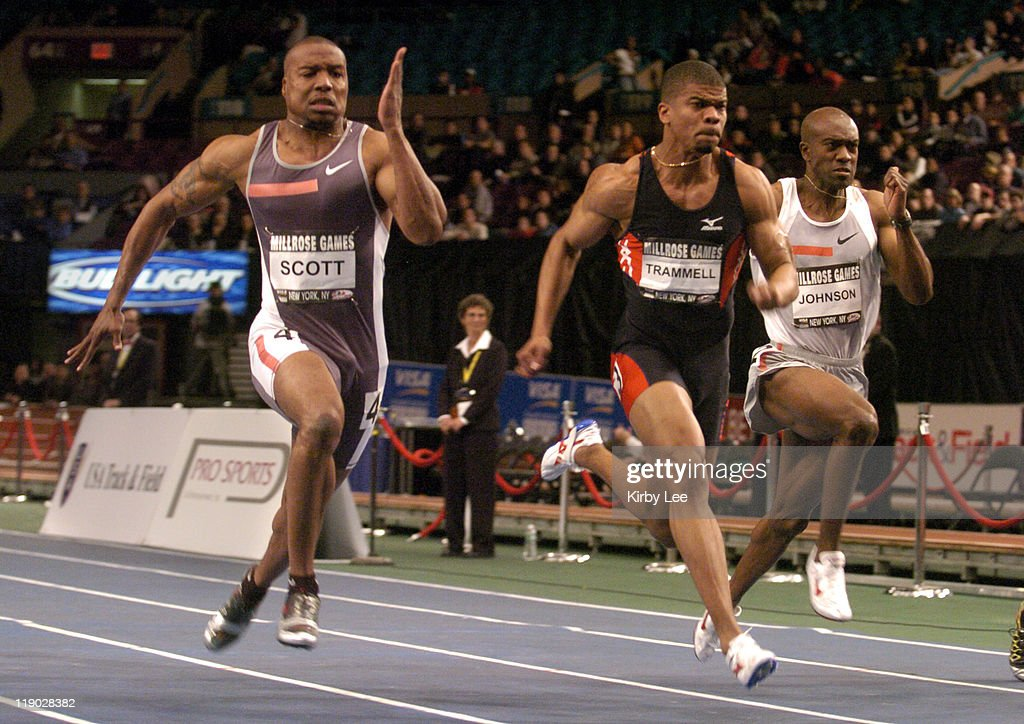 Leonard Scott (left) outsprints Terrence Trammell (center) and Allen Johnson (right) to win the men's 60 meters in 6.59 seconds in the 98th Millrose Games at Madison Square Garden in New York City, NY on Friday, Feb. 4, 2005. Trammell was third in 6.64 and Johnson was fifth in 6.69.