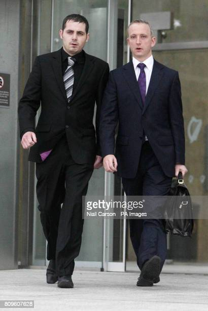 Leonard Watters and Solicitor Cahir O'Higgins leave Dublin District Court after Mr Watters admitted falsely accusing X Factor judge Louis Walsh of...