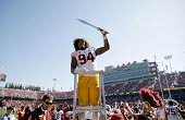 Leonard Williams of the USC Trojans leads the USC marching band after they beat the Stanford Cardinal at Stanford Stadium on September 6 2014 in Palo...