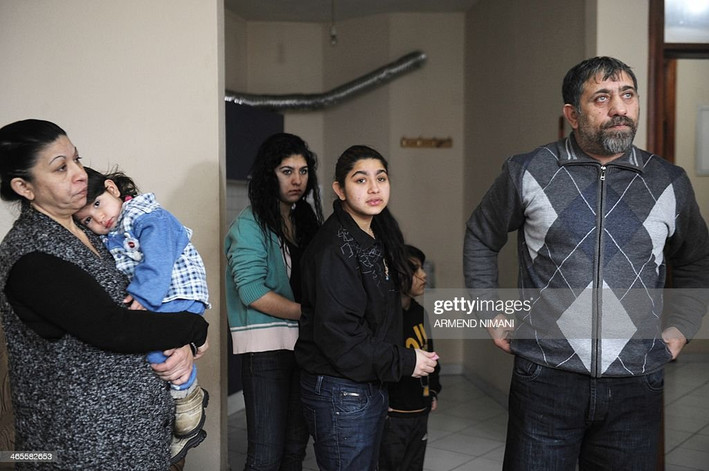 Leonarda Dibrani, 15, (C) waits with her family mother Xhemile (L), sisters Medina (2ndL) and Ljaria (3rdL), brother Hasan (2ndR) and father Resat the ruling of a French court on her appeal for French residency for the family at their home in Mitrovica on January 28, 2014. A French court rejected on January 28 an appeal for residency for the family of the Roma schoolgirl Leonarda Dibrani whose deportation sparked outrage and student protests in the country. A court in the eastern city of Besancon ruled that the public magistrate handling the case had been right in upholding the October 9 expulsion of 15-year-old Leonarda Dibriani, her parents and six siblings to Kosovo. The Dibriani family can appeal the latest ruling. AFP PHOTO / ARMEND NIMANI