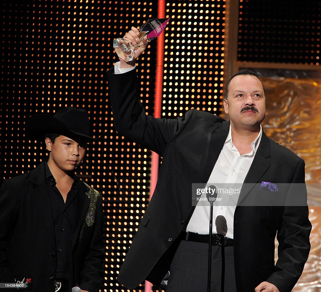 Leonardo Aguilar (L) presents the Legado Musical award to his father <a gi-track='captionPersonalityLinkClicked' href=/galleries/search?phrase=Pepe+Aguilar&family=editorial&specificpeople=2496118 ng-click='$event.stopPropagation()'>Pepe Aguilar</a> at the Billboard Mexican Music Awards presented by State Farm on October 18, 2012 in Los Angeles, California.