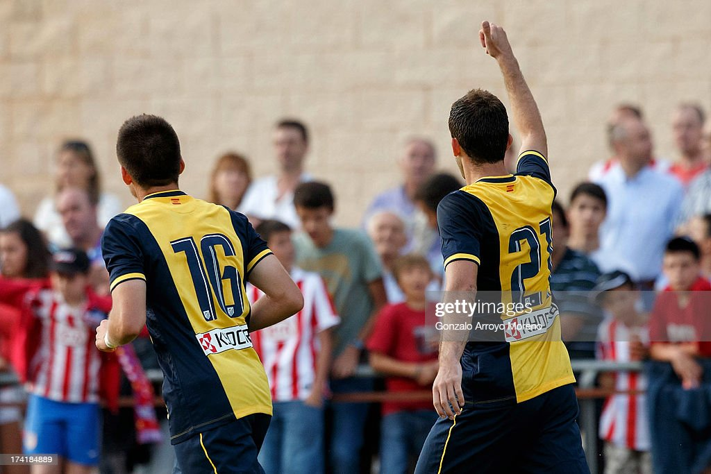 Leonardo Baptistao (R) of Atletico de Madrid celebrates scoring their fourth goal with teammate Daniel aquino Pintos (L) during the Jesus Gil y Gil Trophy between Club Atletico de Madrid and Numancia C. D. at Sporting Club Uxama on July 21, 2013 in Burgo de Osma, Soria, Spain.