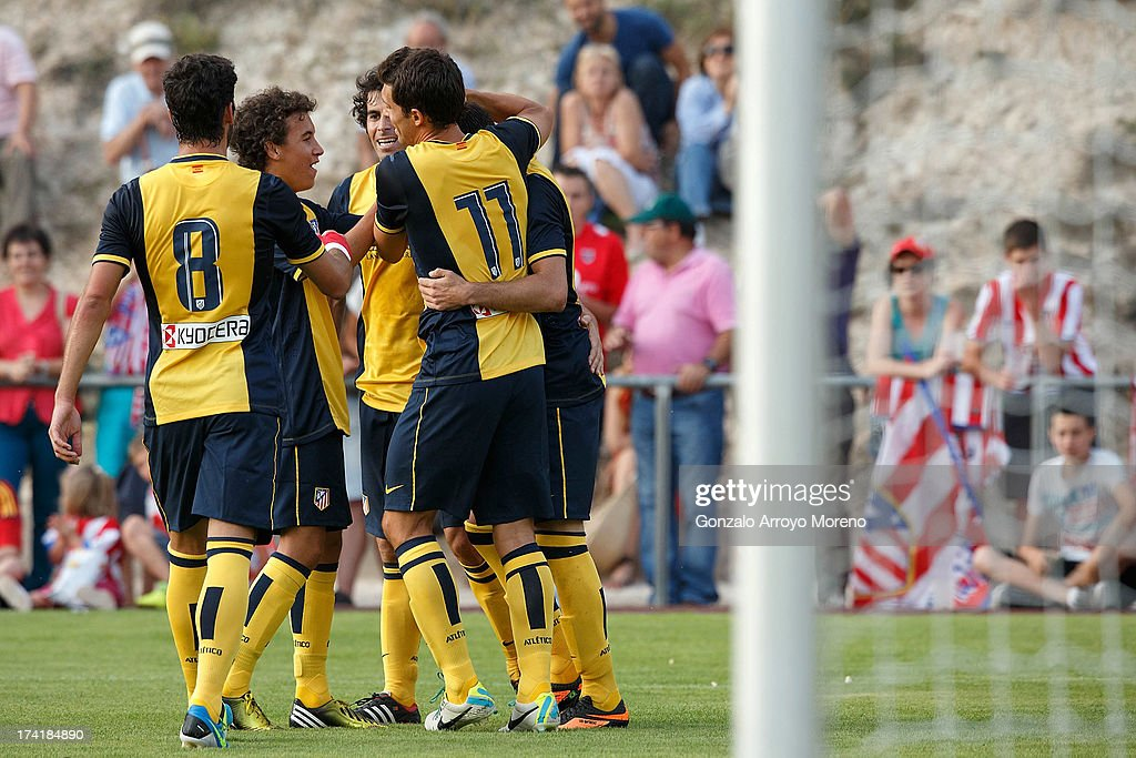 Leonardo Baptistao of Atletico de Madrid celebrates scoring their fourth goal with teammates during the Jesus Gil y Gil Trophy between Club Atletico de Madrid and Numancia C. D. at Sporting Club Uxama on July 21, 2013 in Burgo de Osma, Soria, Spain.