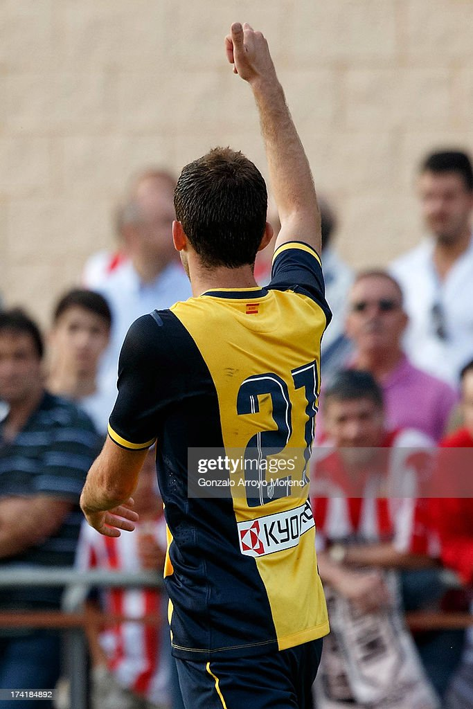 Leonardo Baptistao of Atletico de Madrid celebrates scoring their fourth goal during the Jesus Gil y Gil Trophy between Club Atletico de Madrid and Numancia C. D. at Sporting Club Uxama on July 21, 2013 in Burgo de Osma, Soria, Spain.
