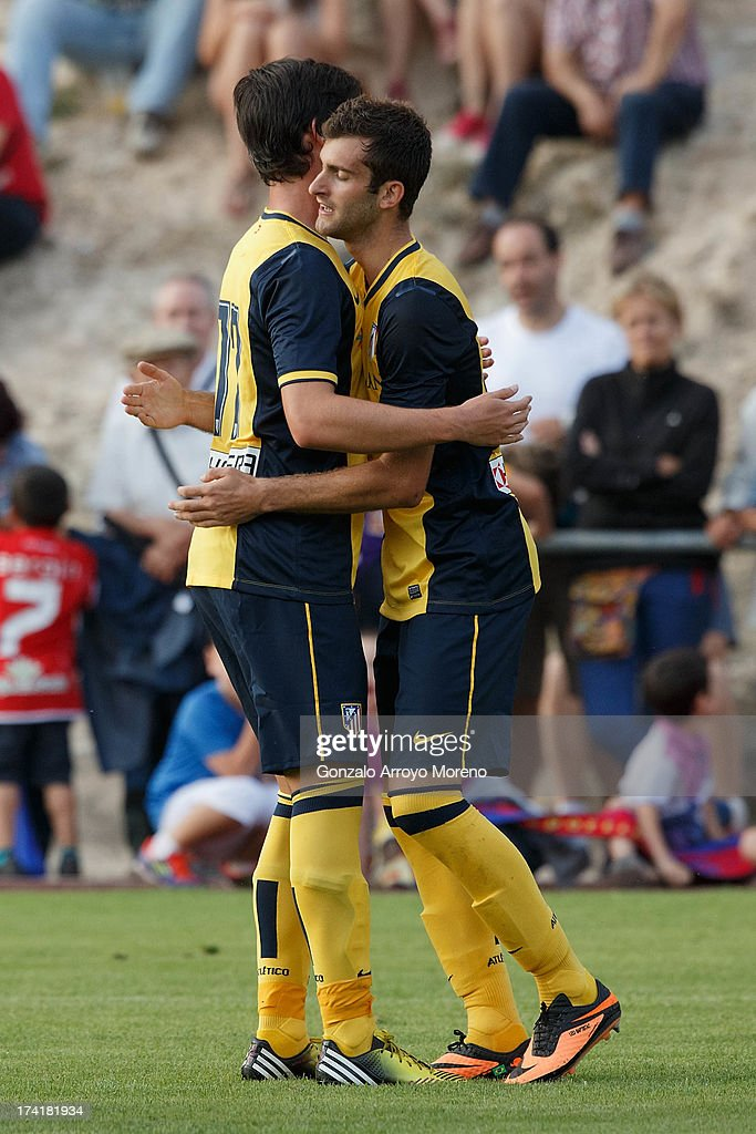 Leonardo Baptistao (R) of Atletico de Madrid celebrates with Ignacio Monsalve after scoring their fourth goal during the Jesus Gil y Gil Trophy between Club Atletico de Madrid and Numancia C. D. at Sporting Club Uxama on July 21, 2013 in Burgo de Osma, Soria, Spain.