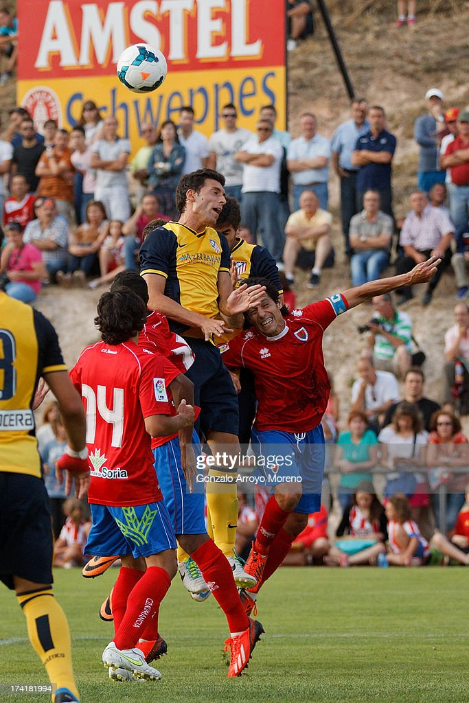 Leonardo Baptistao of Atletico de Madrid rises to score their fourth goal during the Jesus Gil y Gil Trophy between Club Atletico de Madrid and Numancia C. D. at Sporting Club Uxama on July 21, 2013 in Burgo de Osma, Soria, Spain.