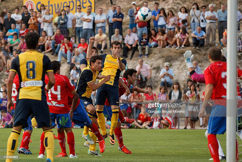 Leonardo Baptistao of Atletico de Madrid scores their fourth goal during the Jesus Gil y Gil Trophy between Club Atletico de Madrid and Numancia C. D. at Sporting Club Uxama on July 21, 2013 in Burgo de Osma, Soria, Spain.