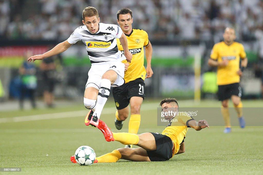 Leonardo Bertone of Young Boys Bern is challenging Thorgan Hazard of Borussia Moenchengladbach during the Champions League Playoff match between...