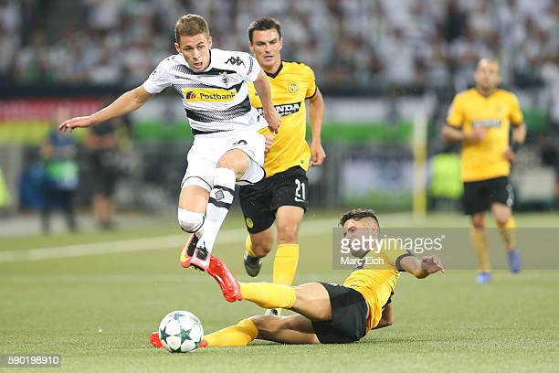 Leonardo Bertone of Young Boys Bern is challenging Thorgan Hazard of Borussia Moenchengladbach during the Champions League Playoff match between...