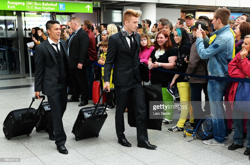 Leonardo Bittenbcourt and <a gi-track='captionPersonalityLinkClicked' href=/galleries/search?phrase=Marco+Reus&family=editorial&specificpeople=5445884 ng-click='$event.stopPropagation()'>Marco Reus</a> of Borussia Dortmund board a plane during their departure at Dortmund Airport on the eve of the UEFA Champions League Final on May 24, 2013 in Dortmund, Germany.