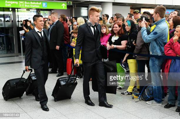 Leonardo Bittenbcourt and Marco Reus of Borussia Dortmund board a plane during their departure at Dortmund Airport on the eve of the UEFA Champions...