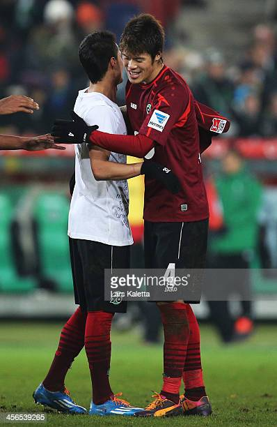 Leonardo Bittencourt and Hiroki Sakai of Hannover celebrate after the Bundesliga match between Hannover 96 and 1 FC Nuremberg at HDIArena on December...