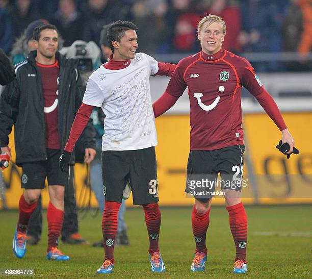 Leonardo Bittencourt and Rajtoral Frantisek of Hannover celebrate their teams win at the end of the Bundesliga match between Hannover 96 and Borussia...