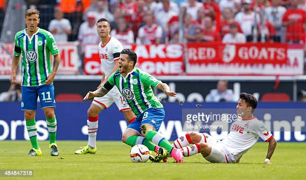 Leonardo Bittencourt of Cologne challenges Vieirinha of Wolfsburg during the Bundesliga match between 1 FC Koeln and VfL Wolfsburg at...