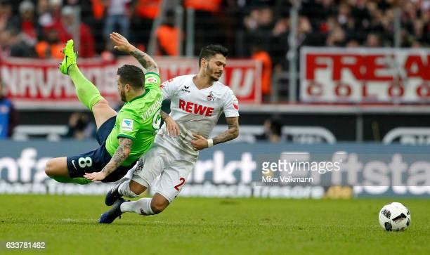 Leonardo Bittencourt of Cologne challenges Vieirinha of Wolfsburg during the Bundesliga match between 1 FC Koeln and VfL Wolfsburg at...