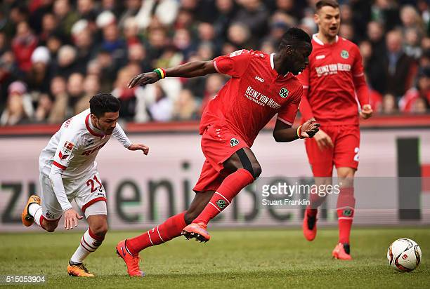 Leonardo Bittencourt of Cologne is challenged by Salif sane of Hannover during the Bundesliga match between Hannover 96 and 1 FC Koeln at HDIArena on...