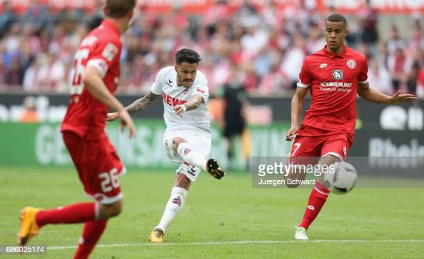 Leonardo Bittencourt of Cologne kicks the ball near Niko Bungert of Mainz and Robin Quaison during the Bundesliga match between 1 FC Koeln and 1 FSV...