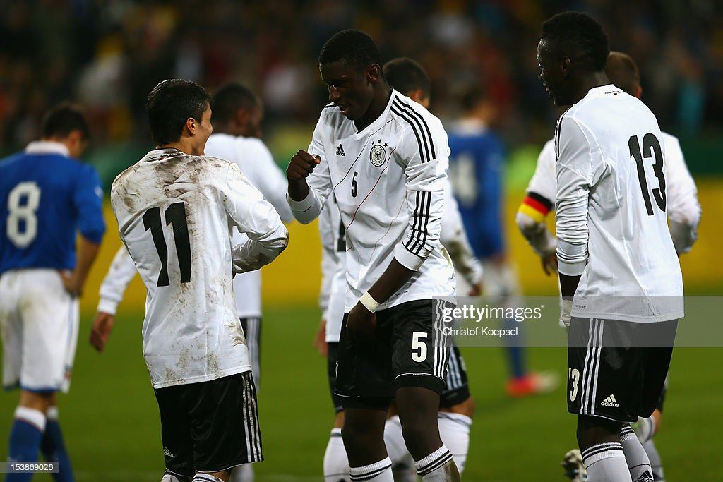 Leonardo Bittencourt of Germany celebrates the forth goal with Anotnio Ruediger and Danny Vieira da Costa during the Under 20 International Friendly match between Germany and Italy at Tivoli-Stadium on October 10, 2012 in Grossaspach, Germany.