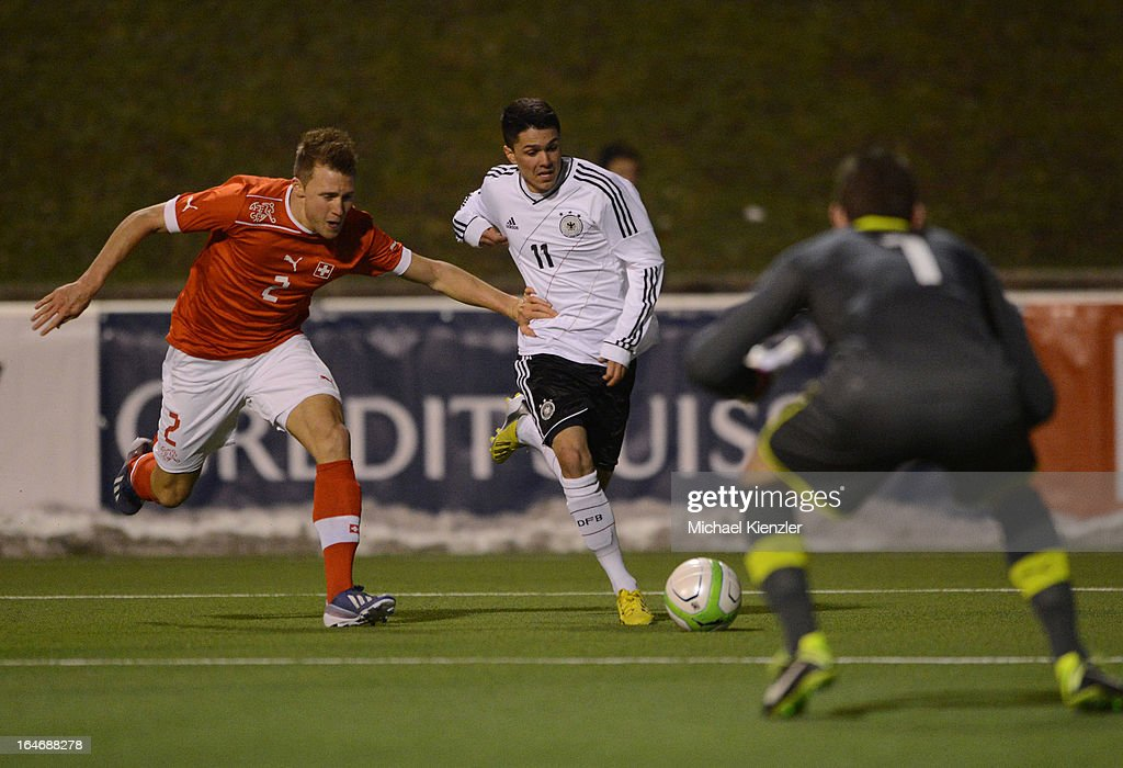 Leonardo Bittencourt (C) of Germany challenges Silvan Widmer of Switzerland during the international friendly match between U20 Switzerland and U20 Germany at Eps Stadium on March 26, 2013 in Baden, Switzerland
