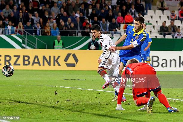 Leonardo Bittencourt of Germany scores the second goal against Mykta Shevchenko and Ivan Ordets of Ukraine during the UEFA U21 Championship Playoff...
