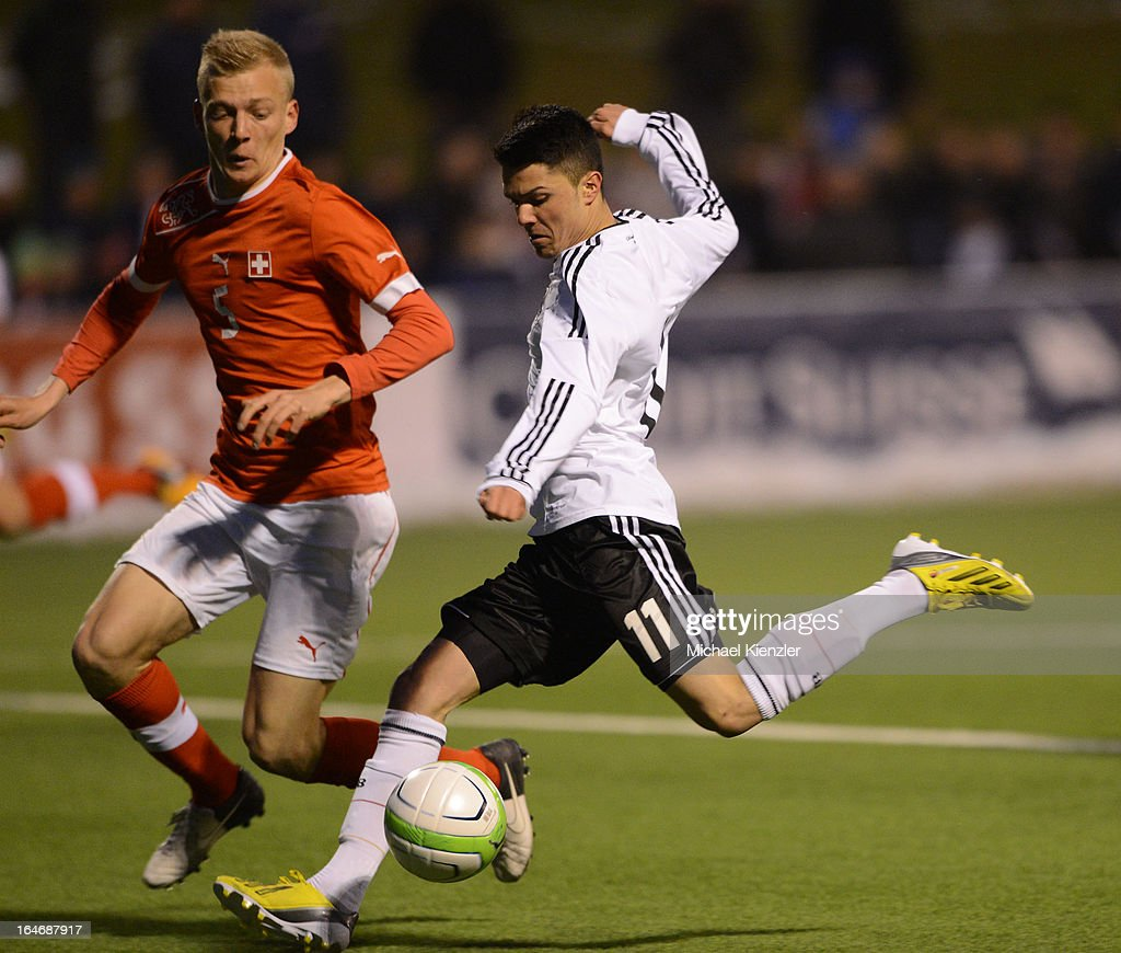 Leonardo Bittencourt of Germany (R) strikes the ball against Saulo Decarli of Switzerland during the international friendly match between U20 Switzerland and U20 Germany at Eps Stadium on March 26, 2013 in Baden, Switzerland