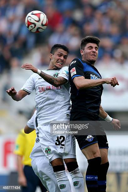 Leonardo Bittencourt of Hannover and Moritz Stoppelkamp of Paderborn go up for a header during the Bundesliga match between SC Paderborn and Hannover...