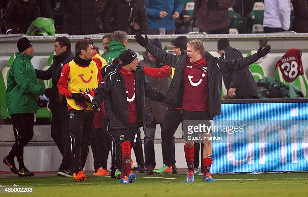 Leonardo Bittencourt of Hannover celebrates with Artjoms Rudnevs at the end of the Bundesliga match between VfL Wolfsburg and Hannover 96 at...