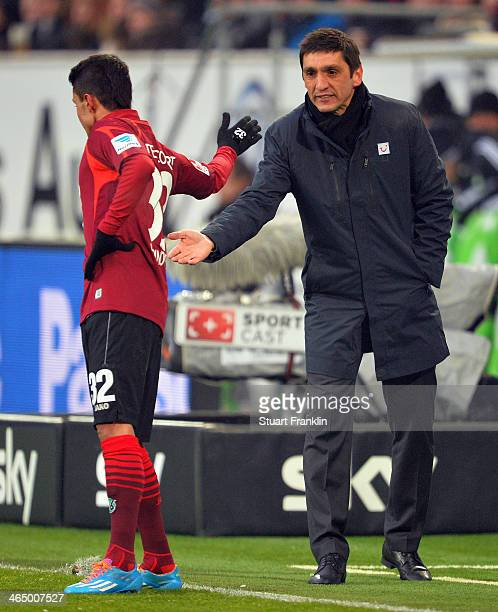 Leonardo Bittencourt of Hannover celebrates with Tayfun Korkut new head coach of Hannover during the Bundesliga match between VfL Wolfsburg and...